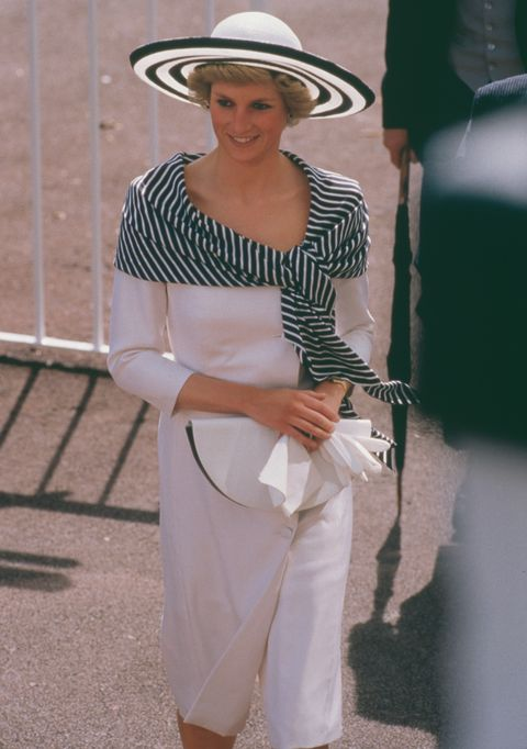 lady di with white midi dress and hat