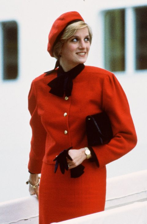 lady di with red two-piece set and beret