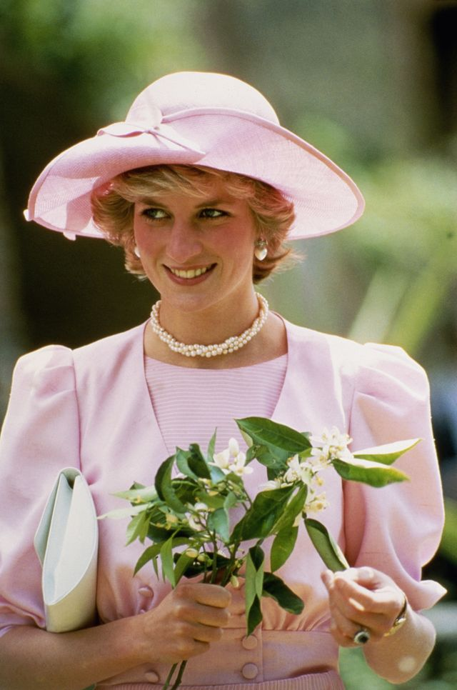 princess diana, wearing a pink outfit by catherine walker and a john boyd hat, during a visit to a fruit farm in sicily, april 1985 photo by jayne finchergetty images