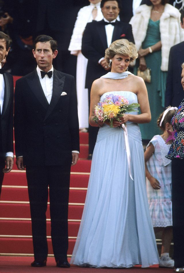 cannes, france   may 15 prince charles, prince of wales and diana, princess of wales, wearing a pale blue silk chiffon strapless dress with a matching chiffon stole designed by catherine walker, attend a gala night in honour of actor sir alec guinness at the cannes film festival on may 15, 1987 in cannes, france photo by anwar husseingetty images