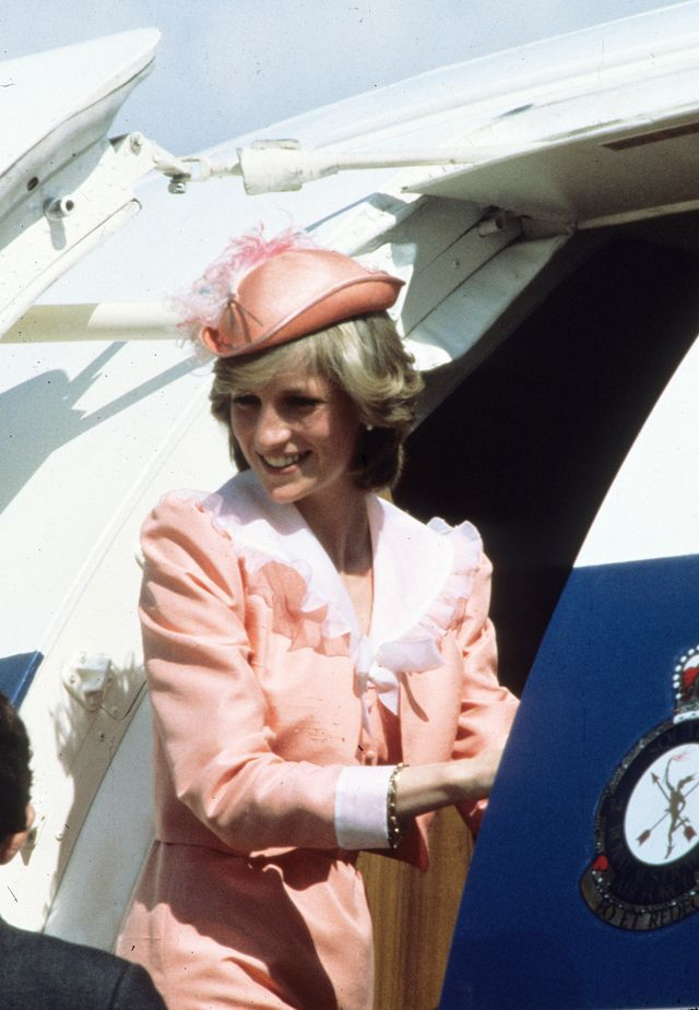 canberra, australia   march 25 diana, princess of wales, wearing a peach coloured dress with a white collar designed by bellville sassoon and a peach archer style hat with a marabou plume designed by john boyd, boards a plane in canberra on march 25, 1983 in new south wales, australia photo by anwar husseinwireimage