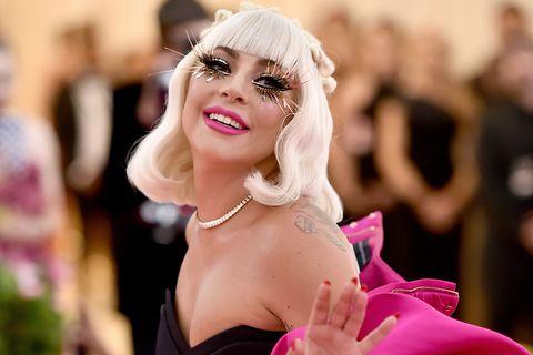 Lady Gaga performs strip tease at Met Gala