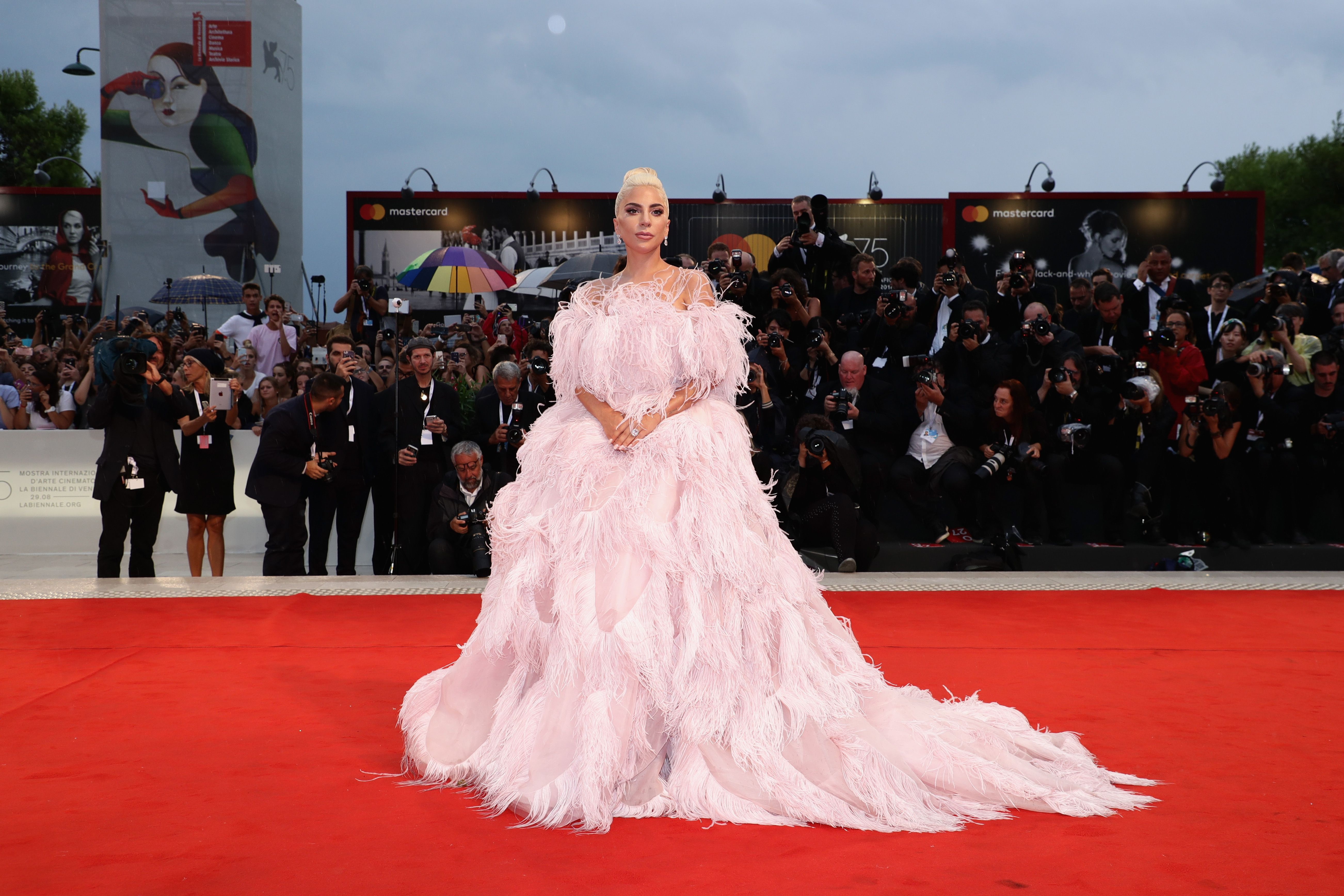 The triple threat hit the red carpet for the premiere of A Star Is Born at the Venice Film Festival wearing a stunning pink feathered Valentino Haute Couture Gown designed by Pierpaolo Piccioli.