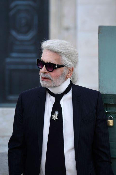 Suit, Eyewear, Glasses, Formal wear, Moustache, Beard, Facial hair, Tuxedo, White-collar worker, Businessperson,