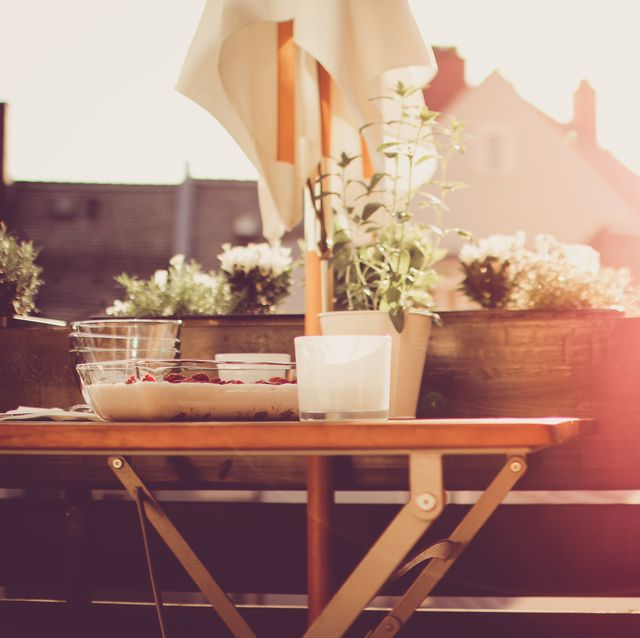 laid table with dessert on balcony during sunset
