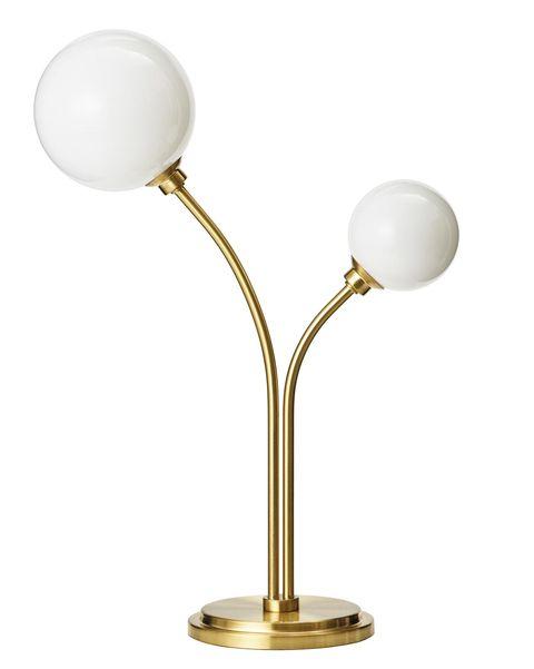Lámpara de mesa en cristal y latón, de H&M