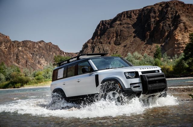 the 2020 land rover defender fording a stream in a off road mountain setting