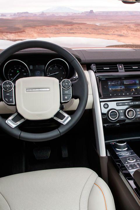 Land vehicle, Vehicle, Car, Steering wheel, Center console, Motor vehicle, Steering part, Luxury vehicle, Range rover, Gear shift,