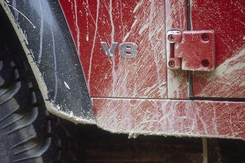 Red, Vehicle door, Automotive exterior, Line, Bumper, Auto part, Wheel, Vehicle, Brick, Car,