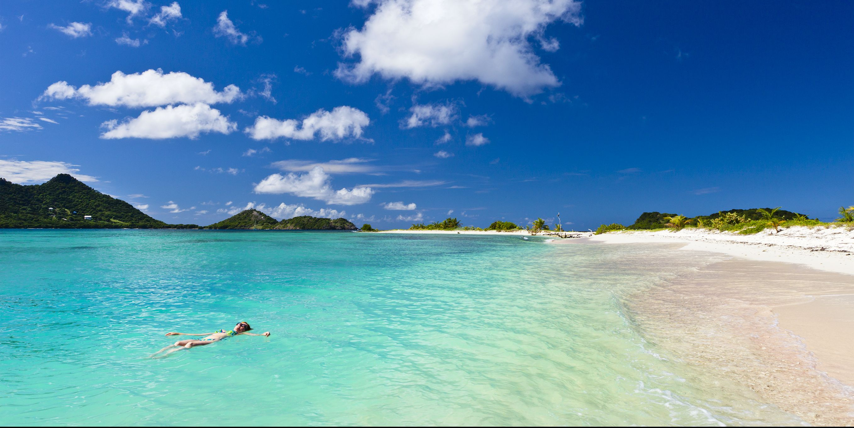 Landscape shot of clear blue water at Sandy Island, Grenada