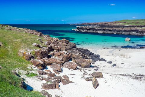 Crystal clear waters and white sand at Langamull beach on the north coast of Mull in the Scottish Hebrides