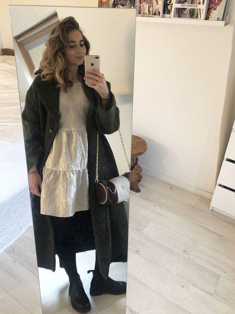 shopping editor kelly met Lange groene mantel