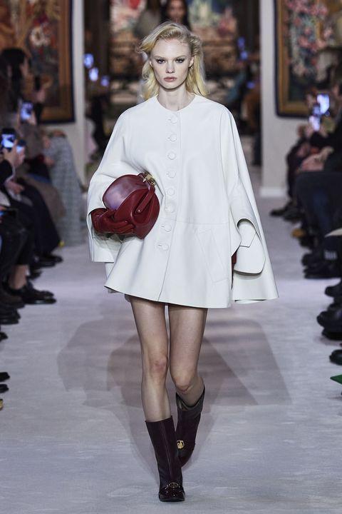 Fashion model, Fashion, Fashion show, Shoulder, Runway, White, Clothing, Joint, Haute couture, Beauty,