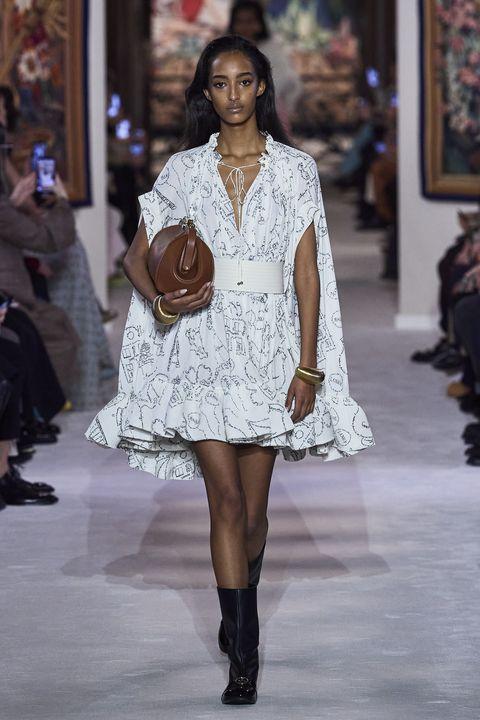Fashion model, Fashion, Fashion show, Runway, Clothing, Shoulder, Haute couture, Joint, Fashion design, Footwear,
