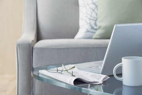 laptop and eyeglasses on coffee table