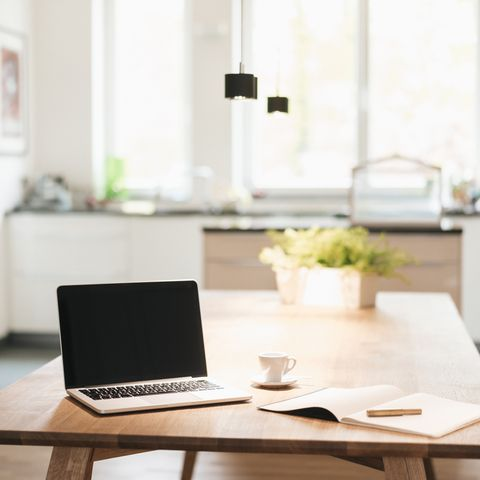 laptop and notebook on table at home