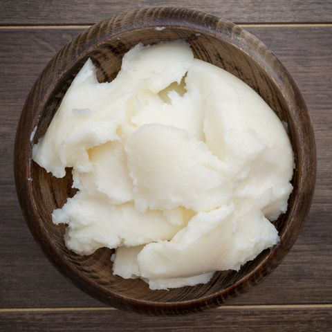 Lard in a bowl on dark rustic background