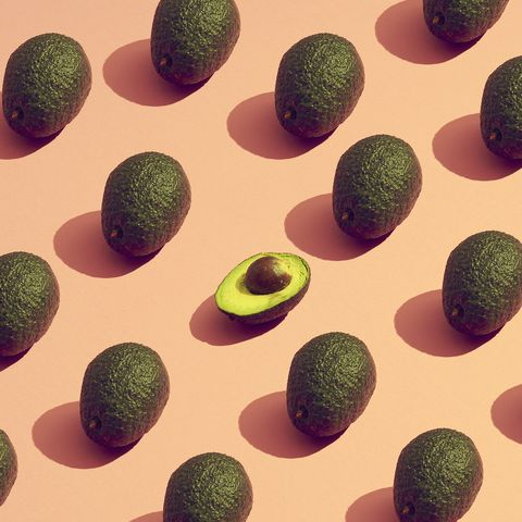 large group of avocados placed in a pattern