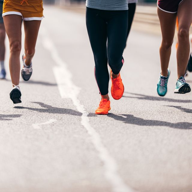 large group of unrecognizable marathon runners having a race on the road
