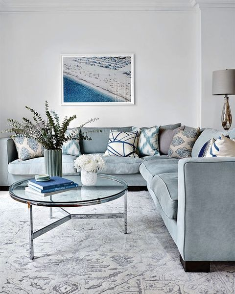Living room, Furniture, Room, Blue, Interior design, Coffee table, Table, Couch, Floor, Property,
