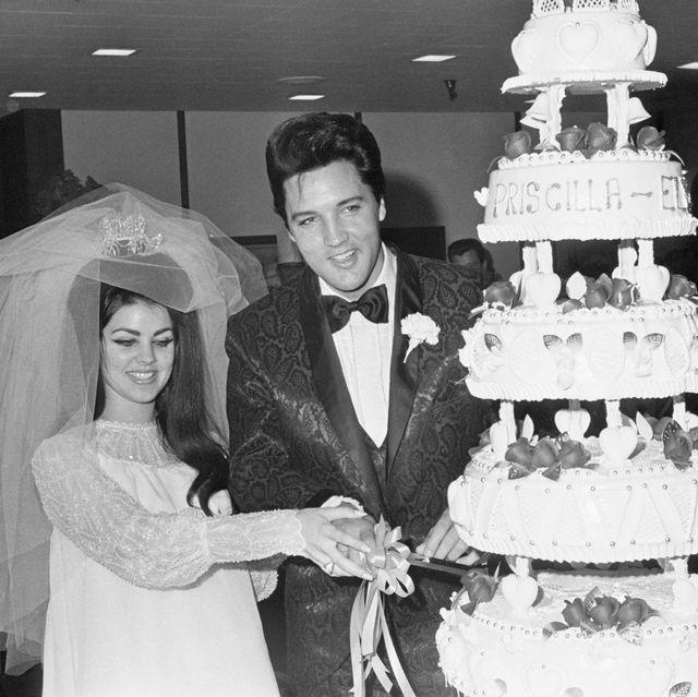 Elvis and Priscilla Presley with Wedding Cake