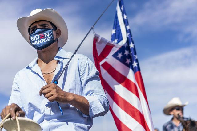 latinx supporters attend a bidenharris nevada hispanic legislative caucus and supporters on horseback rally at the walnut community center's early voting location in las vegas, nevada on saturday, october 24, 2020