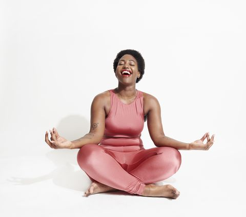 laughing woman in lotus position