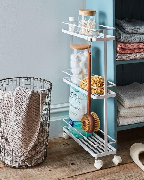 Shelf, Furniture, Shelving, Turquoise, Room, Table, Storage basket, Basket, Interior design, Metal,