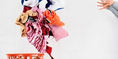 woman tossing laundry