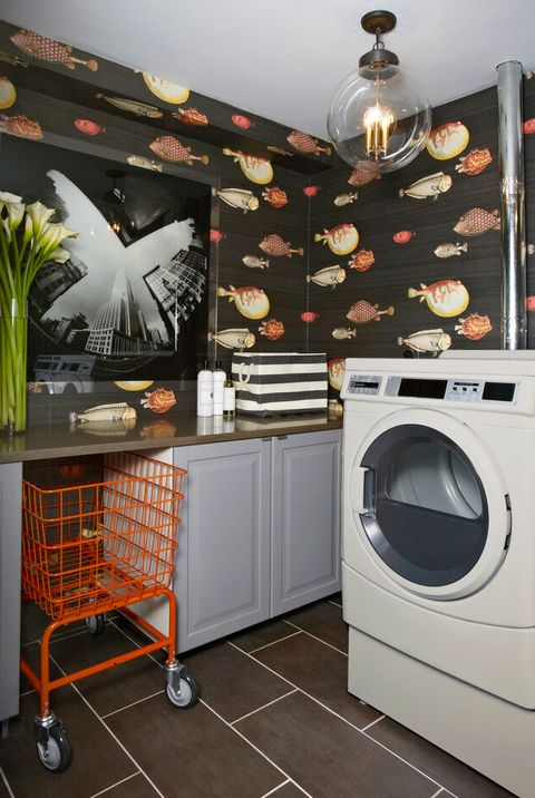 laundry room with fish print wallpaper