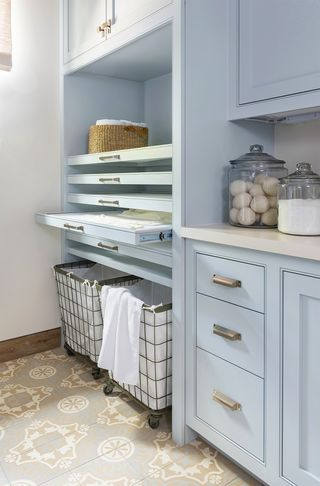 laundry room with pull out shelves