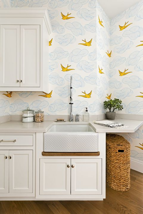 laundry room with bright patterned wallpaper