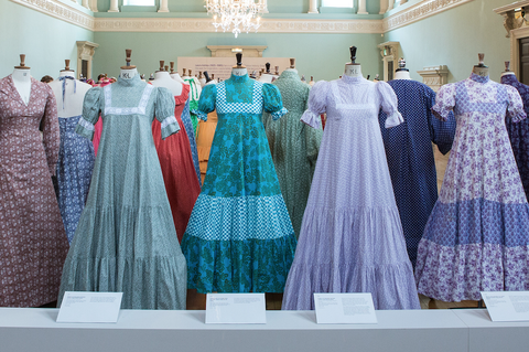 Image of vintage Laura Ashley dresses on display in a museum