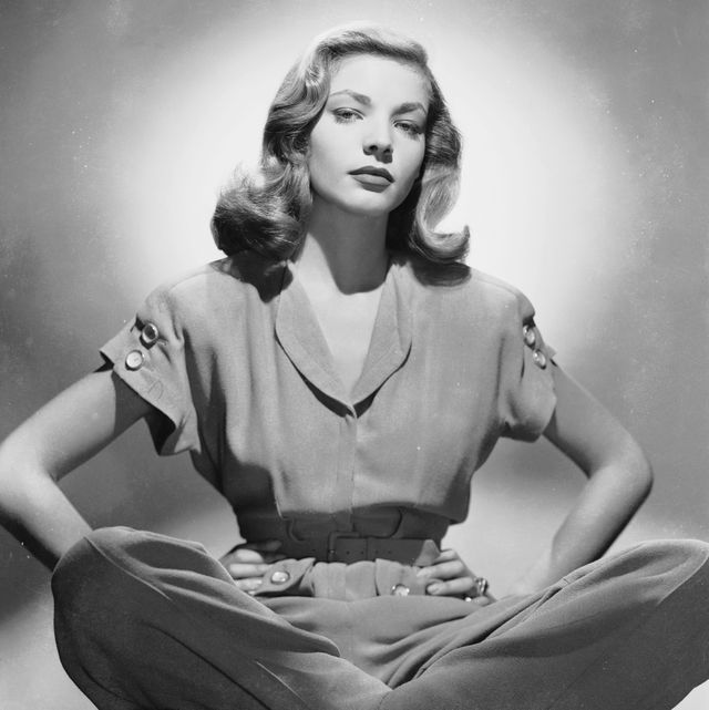 circa 1945  american screen star lauren bacall sitting cross legged in a trouser suit, with her hands on her hips  photo via john kobal foundationgetty images