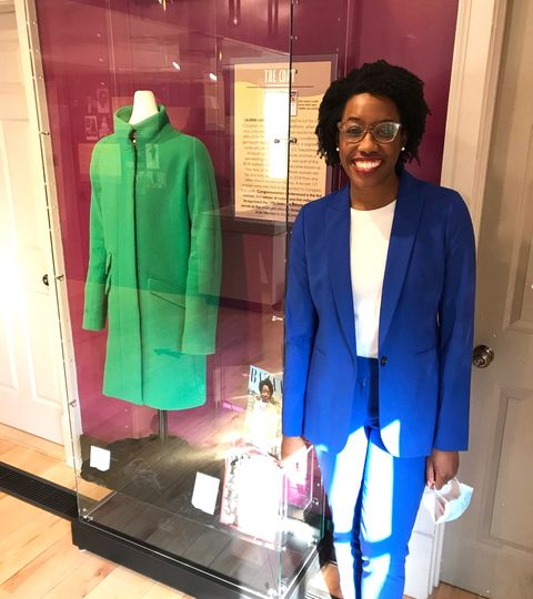 underwood visits her iconic green coat purchased on sale from j crew at naper settlement's women waves of change exhibit