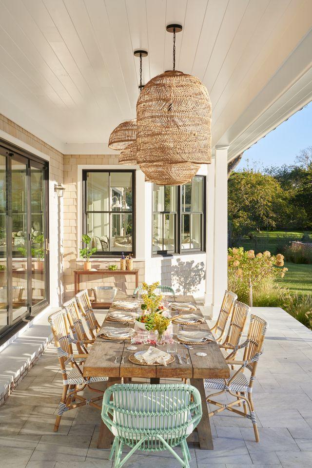lauren wills home tour, outdoor dining area, wood table, deck