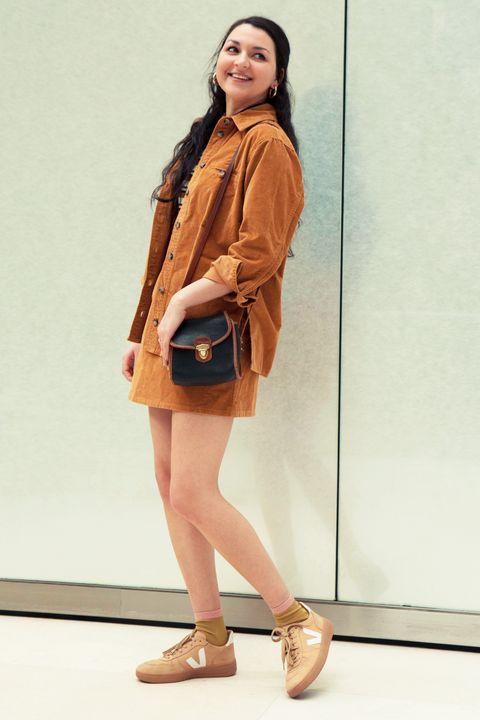 dd46d4c59d Wearing an ASOS Design jacket and skirt, a vintage Dooney & Burke bag, and  Veja sneakers.