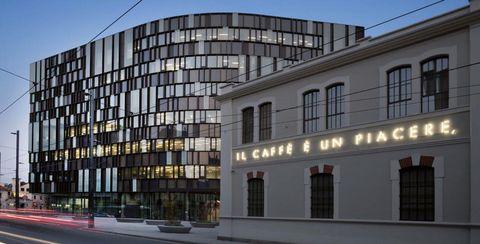 Building, Architecture, Commercial building, Property, Facade, Mixed-use, Condominium, Corporate headquarters, Apartment, Headquarters,