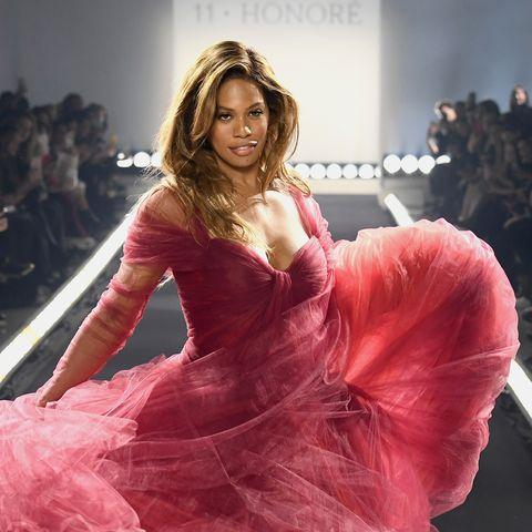 laverne cox walks at new york fashion week in a gauzy pink dress