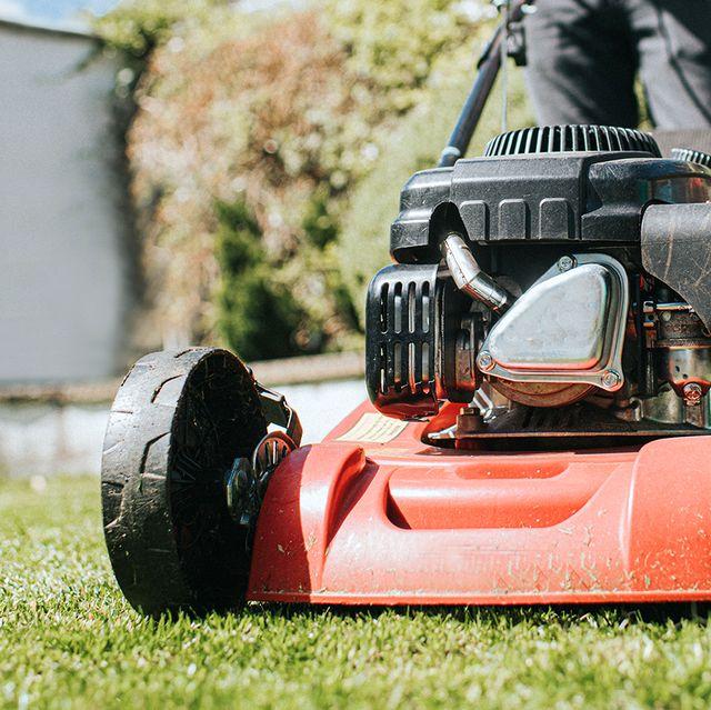 man pushing lawn mower