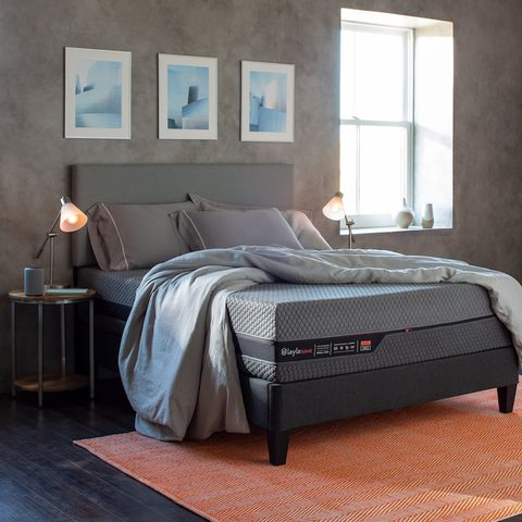 mattress on a frame in a bedroom