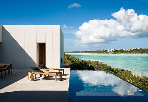 Property, Sky, House, Resort, Natural landscape, Architecture, Swimming pool, Building, Azure, Sea,