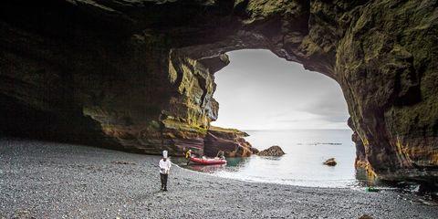 Water, Sea cave, Rock, Formation, Coastal and oceanic landforms, Sea, Cave, Coast, Watercourse, Cove,
