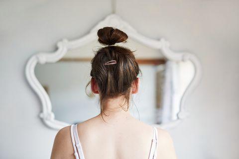 Hair, Shoulder, White, Hairstyle, Bun, Back, Skin, Chignon, Neck, Joint,