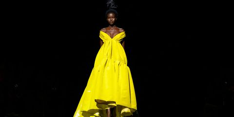 Yellow, Fashion, Fashion model, Performance, Performing arts, Dress, Performance art, Event, Fashion design, Costume design,