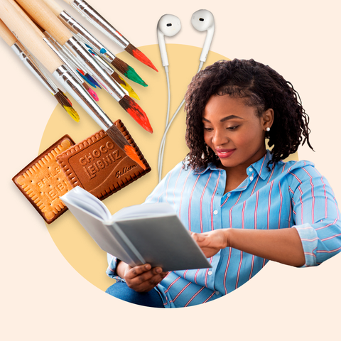 woman reading a book with different relaxing objects around her