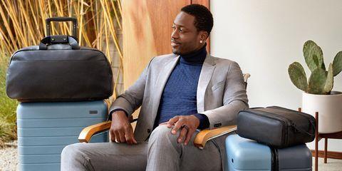Suit, Sitting, Comfort, Businessperson, Formal wear, White-collar worker, Furniture, Room, Chair,