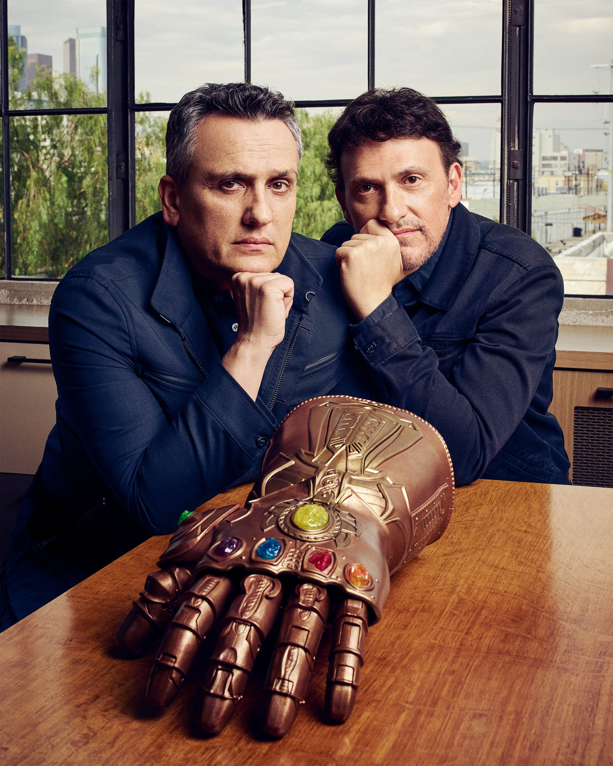 Joe and Anthony Russo, with Thanos's glove from Avengers: Infinity War , at their AGBO studio, Los Angeles. On Joe, left: John Varvatos jacket and trousers, his own; Louis Vuitton polo shirt, his own.