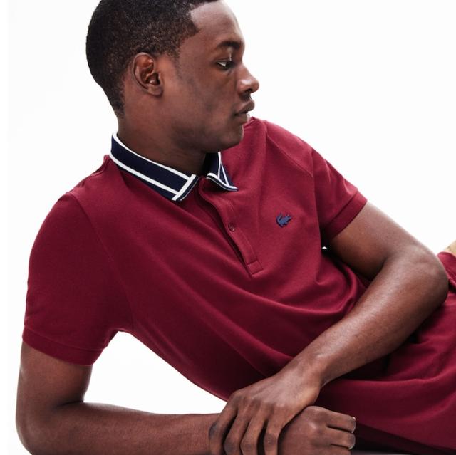 Maroon, Sitting, Arm, Sleeve, Neck, Polo shirt, Outerwear, T-shirt, Collar, Elbow,