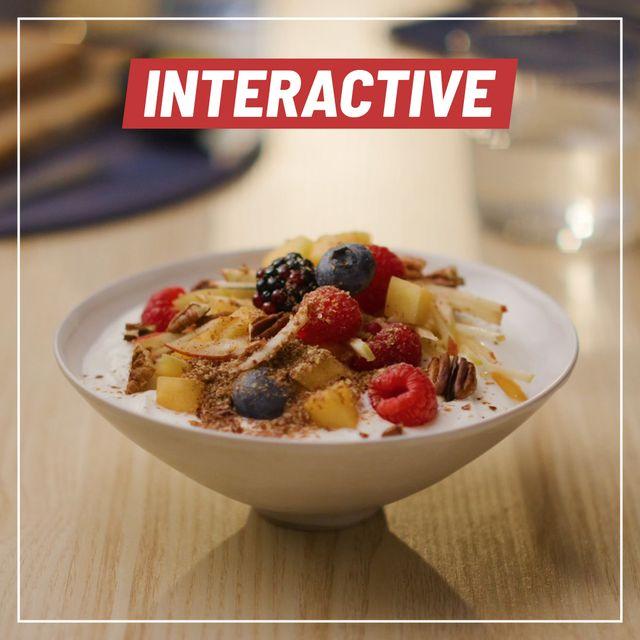 a bowl of arla skyr yogurt with mango, blueberries, raspberries and more on top